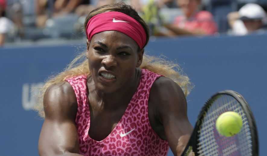 Serena Williams, of the United States, returns a shot to Kaia Kanepi, of Estonia, during the fourth round of the 2014 U.S. Open tennis tournament, Monday, Sept. 1, 2014, in New York. (AP Photo/Charles Krupa)