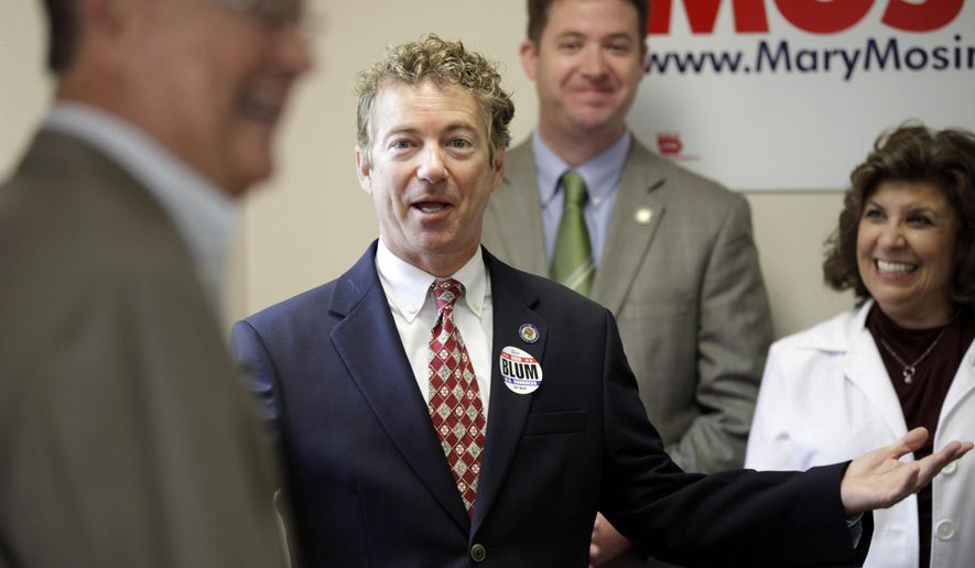 ADVANCE FOR SATURDAY, AUG. 30, AND THEREAFTER - FILE - This Aug. 5, 2014, file photo shows Sen. Rand Paul, R-Ky., as he is introduced to speak during a meeting with local Republicans in Hiawatha, Iowa. One set of elections ends in early November as another begins when presidential hopefuls cross the unofficial starting line in the 2016 race for the White House. With control of the Senate at stake, the months leading up to the mid-term elections offer a clearer window on a crowd of potential presidential candidates already jockeying for position from Nevada to New Hampshire. (AP Photo/Charlie Neibergall, File)