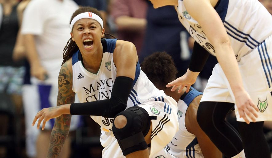 Minnesota Lynx guard Seimone Augustus, left, falls to the floor in celebration with teammate Lindsay Whalen, right, after tying up the score during the second half of Game 2 of the WNBA basketball Western Conference finals against the Phoenix Mercury, Sunday, Aug. 31, 2014, in Minneapolis. The Lynx won 82-77. (AP Photo/The Star Tribune, Kyndell Harkness) MANDATORY CREDIT; ST. PAUL PIONEER PRESS OUT; MAGAZINES OUT; TWIN CITIES LOCAL TELEVISION OUT