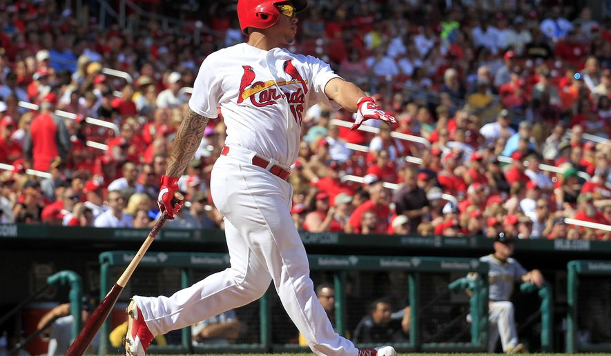 St. Louis Cardinals' Kolten Wong watches his two-run home run during the seventh inning of a baseball game against the Pittsburgh Pirates Monday, Sept. 1, 2014, in St. Louis. (AP Photo/Jeff Roberson)