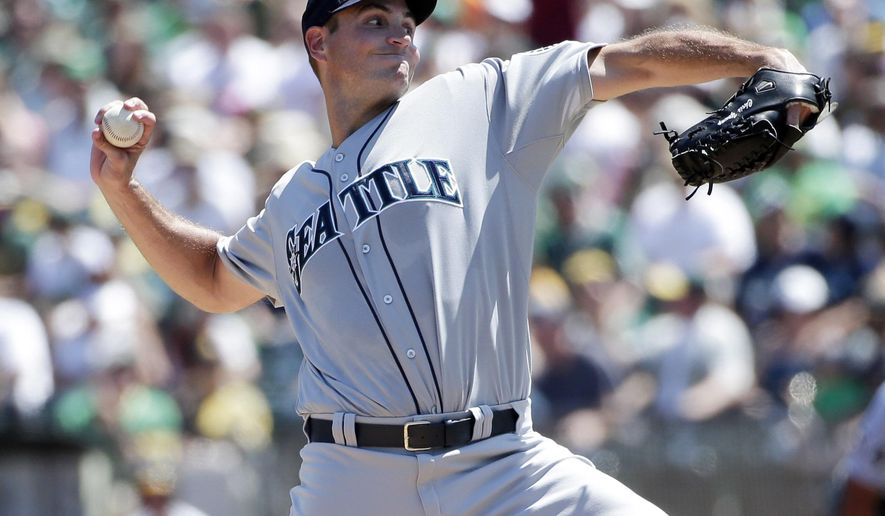Seattle Mariners starting pitcher Chris Young throws to the Oakland Athletics during the first inning of a baseball game on Monday, Sept. 1, 2014, in Oakland, Calif. (AP Photo/Marcio Jose Sanchez)