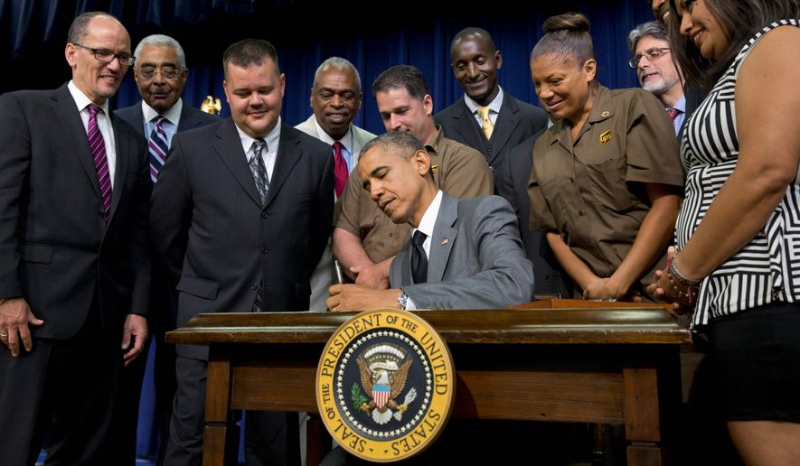 President Obama signed the Fair Pay and Safe Workplace executive order, affecting how contractors do business with the federal government. (Associated Press/File)