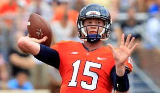 Virginia quarterback Matt Johns (15) throws a pass during the second half of an NCAA college football game against UCLA at Scott Stadium, Saturday, Aug. 30, 2014, in Charlottesville, Va. UCLA won 28-20. (AP Photo/Andrew Shurtleff)