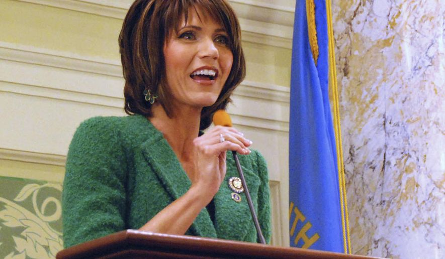 HOLD FOR RELEASE AT 12:01 A.M. CT, SATURDAY,  AUG. 30 - FILE - In this Jan. 22, 2014 file photo, U.S. Rep. Kristi Noem, R-S.D., speaks in Pierre to the South Dakota Senate. There is no such thing as a man's work and a woman's work on South Dakota's expansive farms, and that egalitarian mentality is pushing more women than ever to seek top statewide offices. Noem, seeking her third term, faces a woman Democrat for the state's lone Congressional seat.  Noem said it is imperative that women continue to run because leadership should reflect its population. (AP Photo/Chet Brokaw, File)