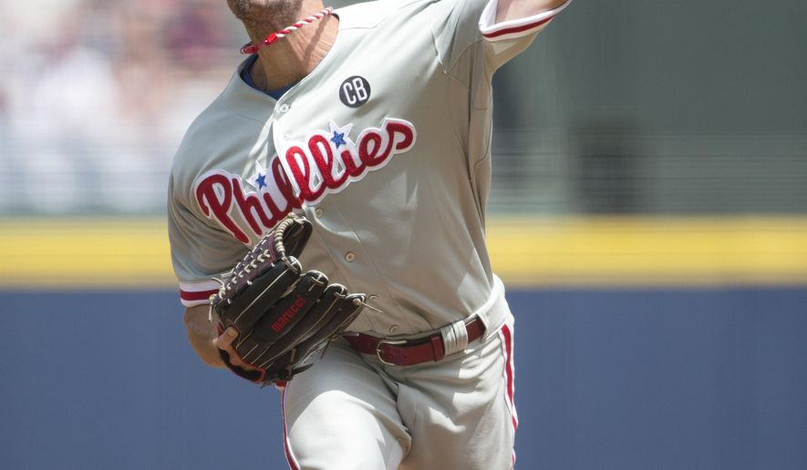 Philadelphia Phillies starting pitcher Cole Hamels works against the Atlanta Braves in the first inning of a baseball game Monday, Sept. 1, 2014, in Atlanta. (AP Photo/John Bazemore)