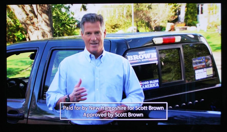 In this Friday, Aug. 29, 2014 photo from a television monitor, Republican U.S. Senate hopeful Scott Brown is seen in one of his commercials.  Brown has run frequent ads targeting Democrat incumbent Jeanne Shaheen while barely mentioning his opponents in the Sept. 9 primary: former U.S. Sen. Bob Smith and former state Sen. Jim Rubens.(AP Photo/Jim Cole)