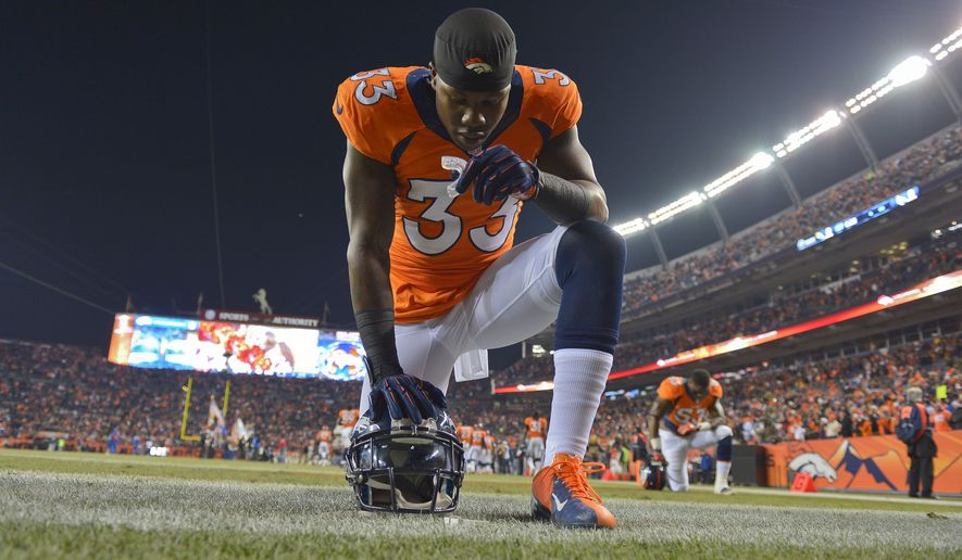 Denver Broncos strong safety Duke Ihenacho (33) kneels in the end zone before playing against the San Diego Chargers in an NFL football game, Thursday, Dec. 12, 2013, in Denver. (AP Photo/Jack Dempsey)