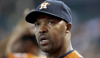 "FILE - In this June 10, 2014, file photo, Houston Astros manager Bo Porter watches the action during the seventh inning of a baseball game against the Arizona Diamondbacks in Phoenix. The Astros have fired manager Bo Porter in his second season with the club. General manager Jeff Luhnow says the decision wasn't based on Houston's record but because ""we need a new direction in our clubhouse."" The Astros entered Monday, Sept. 1, 2014, in fourth place in the AL West with a 59-79 record, second worst in the league.  (AP Photo/Ross D. Franklin, File)"