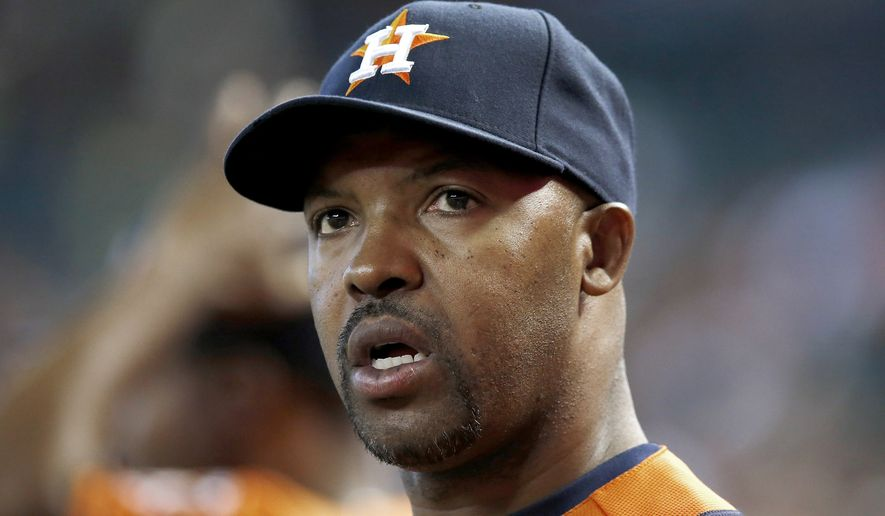"""FILE - In this June 10, 2014, file photo, Houston Astros manager Bo Porter watches the action during the seventh inning of a baseball game against the Arizona Diamondbacks in Phoenix. The Astros have fired manager Bo Porter in his second season with the club. General manager Jeff Luhnow says the decision wasn't based on Houston's record but because """"we need a new direction in our clubhouse."""" The Astros entered Monday, Sept. 1, 2014, in fourth place in the AL West with a 59-79 record, second worst in the league.  (AP Photo/Ross D. Franklin, File)"""