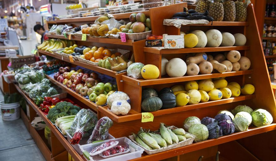 In this April 24, 2014 file photo, a variety of healthy fruits and vegetables are displayed at a market in Washington. (AP Photo/J. Scott Applewhite, File)