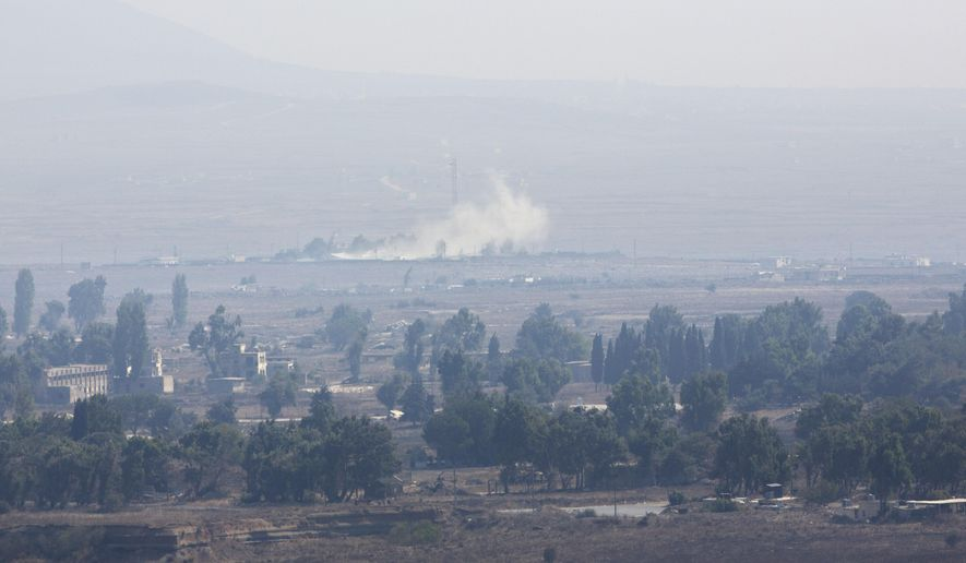 Smoke caused by fighting in Syria is seen from the Israeli-controlled Golan Heights, close to the border with Syria, Monday, Sept. 1, 2014. (AP Photo/Sebastian Scheiner)