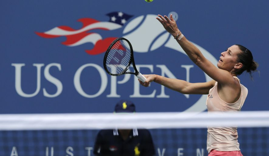 Flavia Pennetta, of Italy, serves against Casey Dellacqua, of Australia, during the fourth round of the 2014 U.S. Open tennis tournament, Monday, Sept. 1, 2014, in New York. (AP Photo/Charles Krupa)