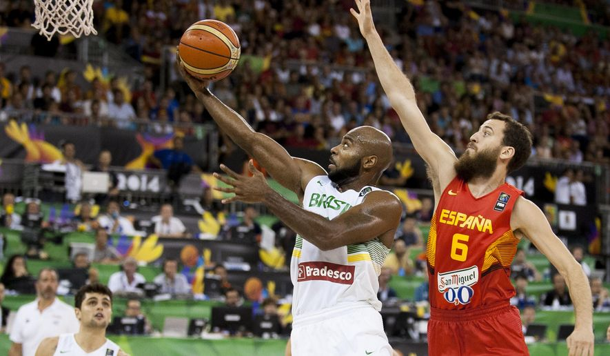 Brazil's Larry Taylor, left, shoots over Spain's Sergio Rodriguez during the Group A Basketball World Cup match between Brazil and Spain in Granada, Spain, Monday Sept. 1, 2014. The 2014 Basketball World Cup competition will take place in various cities in Spain from Aug. 30 through to Sept. 14. (AP Photo/Daniel Tejedor)