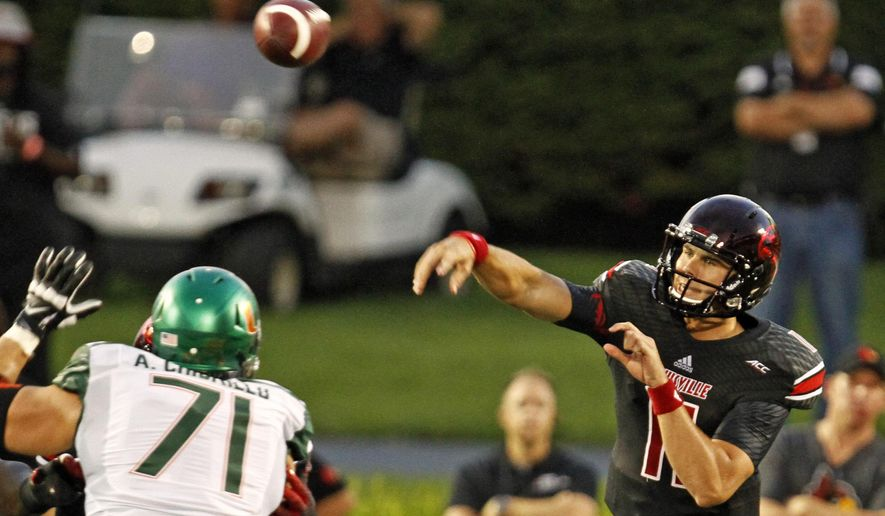Louisville quarterback Will Gardner (11) launches this pass over Miami lineman Anthony Chickillo (71) in the first half of their NCAA college football game in Louisville, Ky., Monday, Sept. 1, 2014. (AP Photo/Garry Jones)