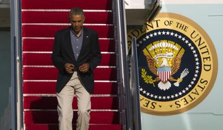 President Barack Obama walks down the stairs of Air Force One upon arrival at Andrews Air Force Base, Md., Monday, Sept. 1, 2014. (AP Photo/Jose Luis Magana)