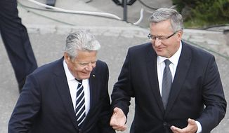 Poland's President Bronislaw Komorowski, right, and his German counterpart Joachim Gauck take part in a ceremony marking 75 years since World War II started, at Westerplatte in Gdansk, Poland, Monday Sept. 1, 2014. Some of the first shots of World War II were fired on Sept. 1, 1939 by an attacking Nazi German warship on Westerplatte, a Polish munitions depot that held off for many days. More than five years of brutal, global war followed, taking the lives of tens of millions of people. (AP Photo/Czarek Sokolowski)