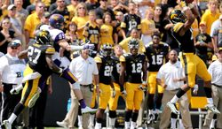 Iowa defensive back Greg Mabin, right, intercepts a pass intended for Northern Iowa wide receiver Brett LeMaster late in the fourth quarter of an NCAA college football game Saturday, Aug. 30, 2014, in Iowa City, Iowa. Iowa won the game 31-23. (AP Photo/Justin Hayworth)