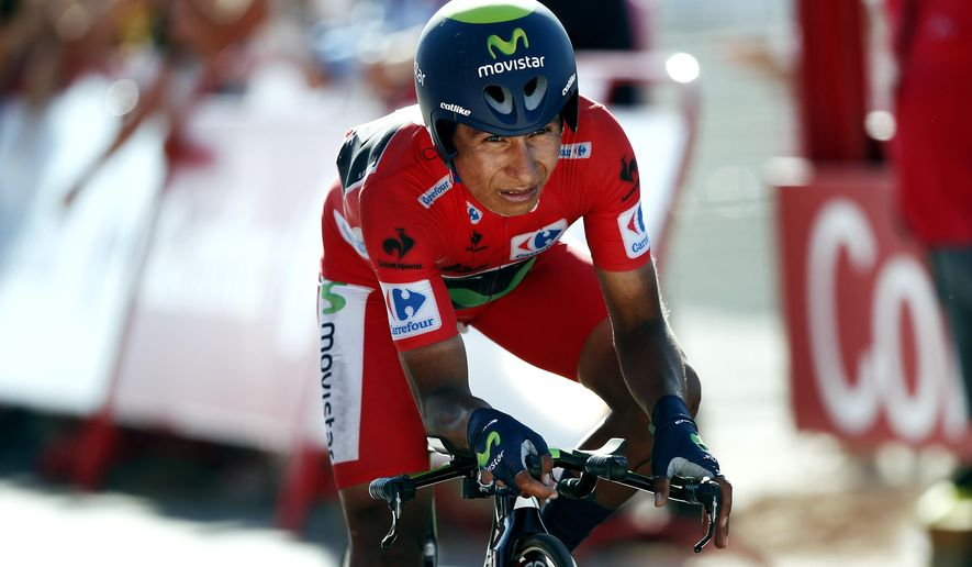 Nairo Quintana from Colombia, at the time-trial arrival after his fall and his loss of time in the general classification. 36,7 kilometers (22-mile) time trial, Real Monasterio Santa Maria de Varuela-Borja, the 10th stage of the Spanish Vuelta cycling race,  in Borja, Spain, Tuesday, Sept. 2, 2014. (AP Photo/Ivan Aguinaga)