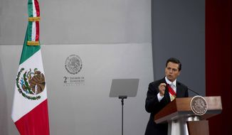 Mexico's President Enrique Pena Nieto gives his second state-of-the-nation address inside the National Palace in Mexico City, Tuesday, Sept. 2, 2014.  (AP Photo/Eduardo Verdugo)
