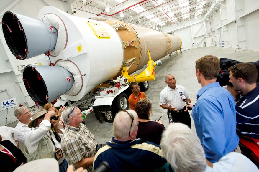 NASA Administrator Charles Bolden, stands in front of the Atlas V first stage booster which relies on Russian-made RD-180 rocket engines. Lawmakers and national security analysts said they were aghast that the military allowed itself to become so dependent on Russian military technology during an era of uneasy relations. (Associated Press)