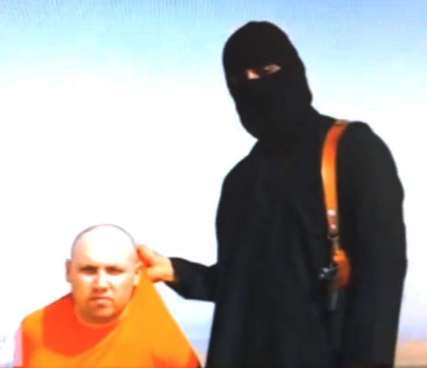 The man believed to be Steven Sotloff is shown on his knees in an orange jumpsuit. In what was highly likely a coerced speech, he blames his impending death on U.S. policy, and is then beheaded on camera. (SITE Intelligence Group via Associated Press)