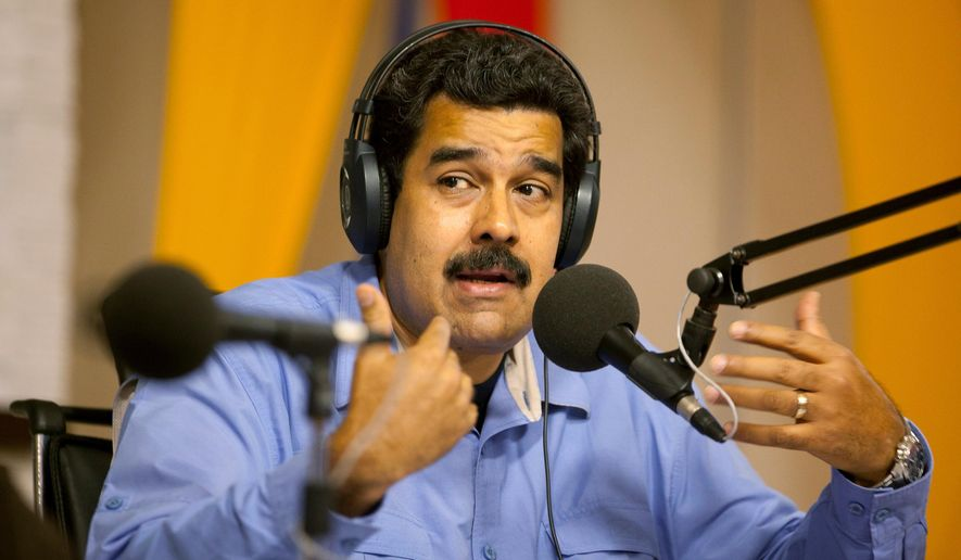 """FILE - In this March 11, 2014 file photo, Venezuela's President Nicolas Maduro speaks on his radio and television program called """"In contact with Maduro"""" at Miraflores presidential palace in Caracas, Venezuela. Critics have mostly ignored the new TNT spy drama """"Legends,"""" but it's creating a furor in Venezuela. The telecommunications commission opened an investigation on Tuesday, Sept. 2, 2014 into the series over an episode in which a character fingers Maduro and his socialist party as the buyer of chemical weapons. (AP Photo/Alejandro Cegarra, File)"""