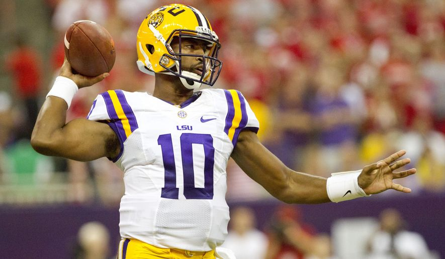 LSU quarterback Anthony Jennings drops back to throw during the first half against Wisconsin during an NCAA college football game Saturday, Aug. 30, 2014, in Houston. (AP Photo/The Courier, Jason Fochtman)