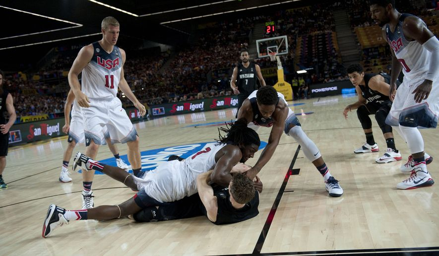 New Zealand's Thomas Abercrombie, and Kenneth Faried of the U.S, bottom, duel for the ball during the Group C Basketball World Cup match, in Bilbao northern Spain, Tuesday, Sept. 2, 2014. The 2014 Basketball World Cup competition take place in various cities in Spain from  last Aug. 30 through to Sept. 14. (AP Photo/Alvaro Barrientos)
