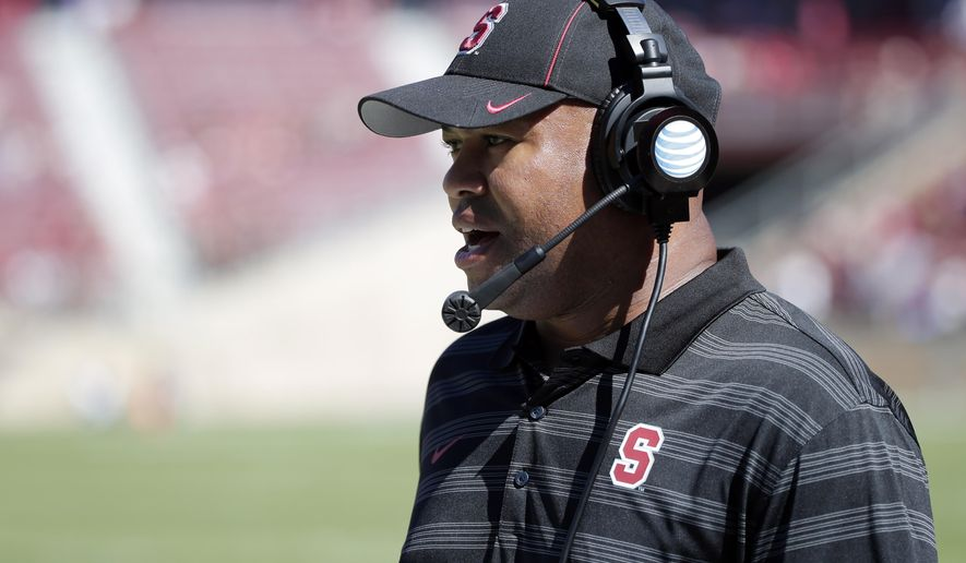Stanford head coach David Shaw watches his team play UC Davis during the second half of an NCAA college football game on Saturday, Aug. 30, 2014, in Stanford, Calif. (AP Photo/Marcio Jose Sanchez)