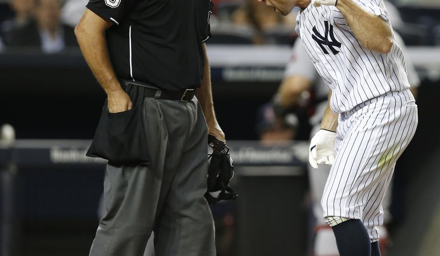 New York Yankees' Brett Gardner reacts after home plate umpire Tim Timmons ejected him from the baseball game for tossing his helmet after Timmons called Gardner out on strikes to end the fifth inning against the Boston Red Sox at Yankee Stadium in New York, Tuesday, Sept. 2, 2014. (AP Photo/Kathy Willens)