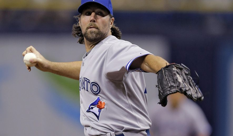 Toronto Blue Jays starting pitcher R.A. Dickey delivers to the Tampa Bay Rays during the first inning of a baseball game Tuesday, Sept. 2, 2014, in St. Petersburg, Fla. (AP Photo/Chris O'Meara)