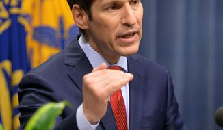 Dr. Tom Frieden, director of the U.S. Centers for Disease and Control, holds a media briefing on Tuesday, Sept. 2, 2014, in Atlanta. The briefing included a public health assessment of the Ebola outbreak in West Africa, and an update on efforts to control the spread of the outbreak. (AP Photo/Atlanta Journal-Constitution, Kent D. Johnson)  MARIETTA DAILY OUT; GWINNETT DAILY POST OUT; LOCAL TELEVISION OUT; WXIA-TV OUT; WGCL-TV OUT