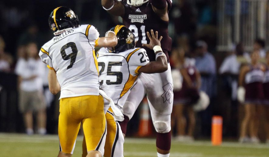 In this Aug. 30, 2014, photo, Southern Mississippi quarterback Nick Mullens (9) throws a pass by Mississippi State defensive lineman Preston Smith, right, in the second half of an NCAA college football game at Davis Wade Stadium in Starkville, Miss. Smith was named the SEC's Defensive Lineman of the Week after his performance that included an interception and a blocked field goal in the team's 49-0 win. (AP Photo/Rogelio V. Solis)