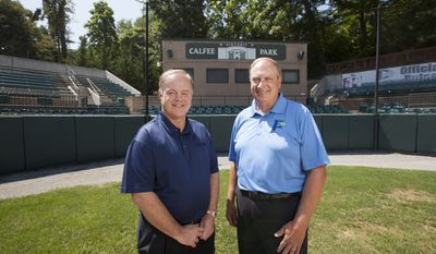 Incoming owner David Hagan, left, stands with outgoing owner, Wayne Carpenter, on the field of Calfee Park. Hagan and a business partner, Larry Shelor, purchased the park from Carpenter and his business partners, Tom Compton and Rick Mansell, who had operated the park for 25 years. Amanda Loman/Special to The Washington Times.