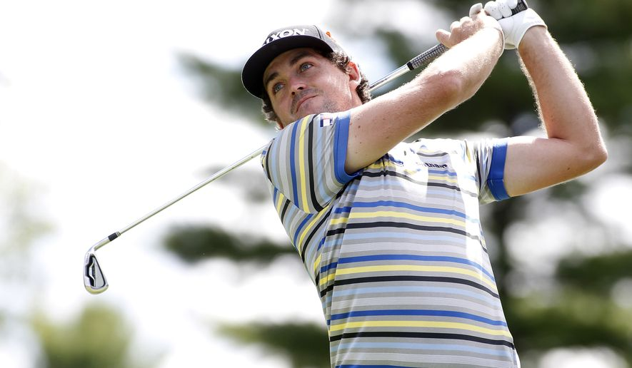 FILE - In this Aug. 29, 2014, file photo, Keegan Bradley hits off the 10th tee during the first round of the Deutsche Bank Championship golf tournament in Norton, Mass. (AP Photo/Stew Milne, File)