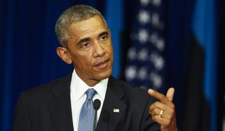 U.S. President Barack Obama gestures while speaking during his and Estonian President Toomas Hendrik Ilves's news conference at the Bank of Estonia in Tallinn, Estonia, Wednesday, Sept. 3, 2014. Wednesday's statement came as U.S. President Barack Obama arrived in Estonia in a show of solidarity with NATO allies who fear they could be the next target of Russia's aggression. (AP Photo/Mindaugas Kulbis)