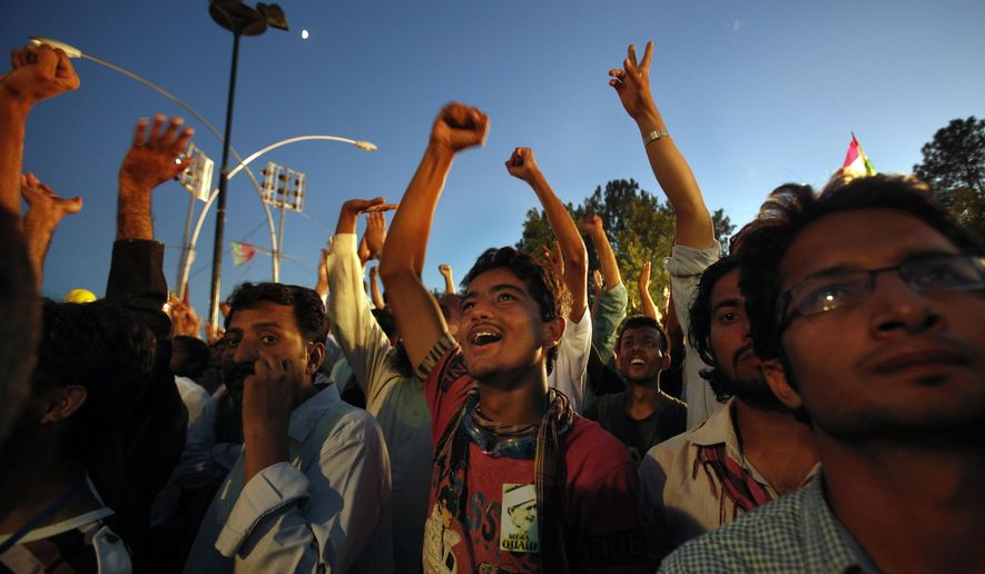 Supporters of Pakistan's fiery cleric Tahir-ul-Qadri chant slogans during a protest near Prime Minister's home in Islamabad, Pakistan, Tuesday, Sept. 2, 2014. Anti-government demonstrators led by opposition politician Khan and Tahir-ul-Qadri converged on the capital in mid-August, demanding Sharif's ouster over alleged fraud in last year's election. Their protests turned violent this past weekend, when clashes between demonstrators and security forces killed many and wounded hundreds. (AP Photo/Anjum Naveed)