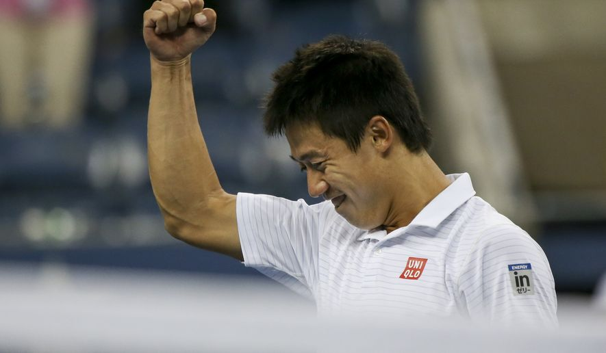 Kei Nishikori, of Japan, reacts after defeating Stan Wawrinka, of Switzerland, in five sets during the quarterfinals of the 2014 U.S. Open tennis tournament, Wednesday, Sept. 3, 2014, in New York. (AP Photo/Mike Groll)