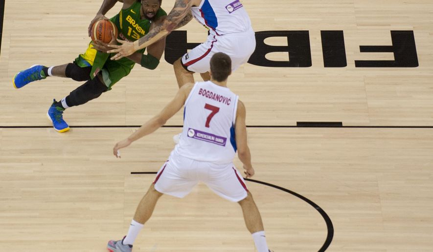 Brazil's Nene Hilario, left, shoots over Serbia's Miroslav Raduljica, right, and Bogdan Bogdanovic, bottom, during the Group A Basketball World Cup match in Granada, Spain, Wednesday, Sept. 3, 2014. The 2014 Basketball World Cup competition will take place in various cities in Spain from Aug. 30 through to Sept. 14. (AP Photo/Daniel Tejedor)