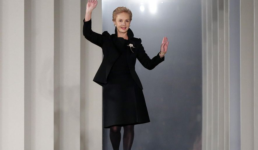 FILE - In this Feb. 10, 2014 file photo, Designer Carolina Herrera acknowledges audience applause after her Fall 2014 collection was modeled during Fashion Week in New York. Seth Meyers, who celebrated his one year anniversary this week, says designer Herrera was his wedding day fairy godmother.  The Venezuelan designer was honored, Wed., Sept. 3, 2014, with the Couture Council Award for Artistry of Fashion.  (AP Photo/Richard Drew, file)