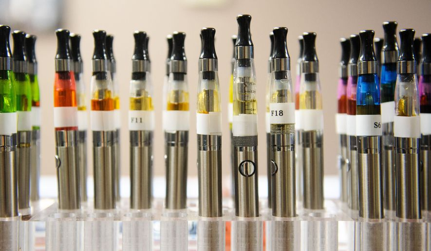In this July 23, 2014 photo are a variety of e-cigarette at Aqueous Vapor in Columbia, Mo. Gov. Jay Nixon is eliciting support from health professionals as he tries to persuade Missouri lawmakers to sustain his veto of legislation dealing with electronic cigarettes.(AP Photo/The Columbia Daily Tribune, Nick Schnelle)