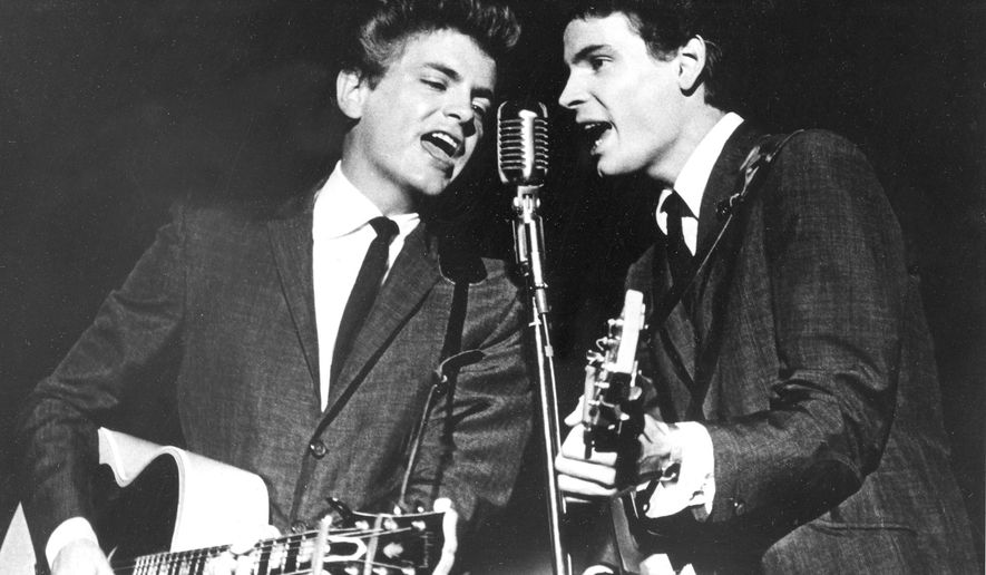 FILE - In this July 31, 1964 file photo The Everly Brothers, Phil, left, and Don, perform on stage. Graham Nash, Vince Gill and Emmylou Harris are among the performers set to pay tribute to the Everly Brothers in October 2014. The Rock and Roll of Fame announced Wednesday, Sept. 3, 2014, that Peter Asher, Shelby Lynne and the Secret Sisters will also perform at the Oct. 25 event at PlayhouseSquare's State Theatre in Cleveland. Phil Everly died from chronic obstructive pulmonary disease earlier this year. Surviving member Don Everly will attend. (AP Photo, File)