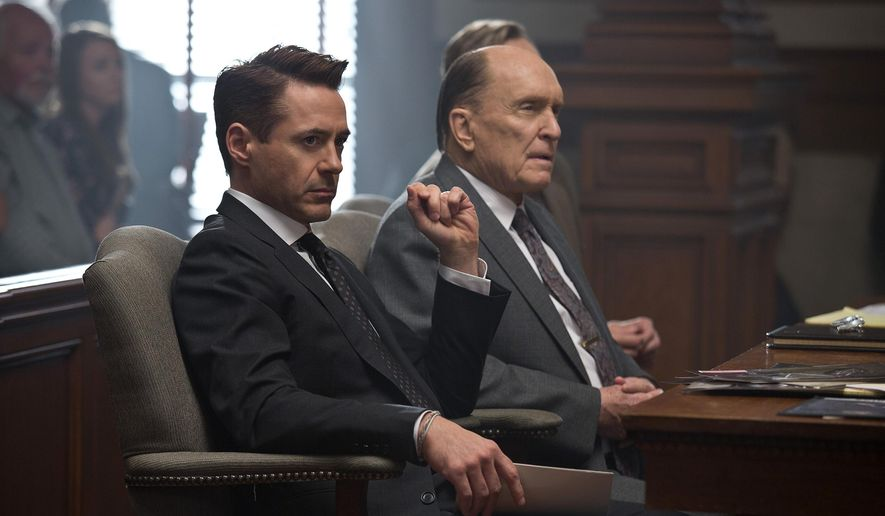 """This image released by Warner Bros. Pictures shows Robert Downey Jr., left, and Robert Duvall in a scene from the film, """"The Judge."""" (AP Photo/Warner Bros. Pictures,  Claire Folger)"""