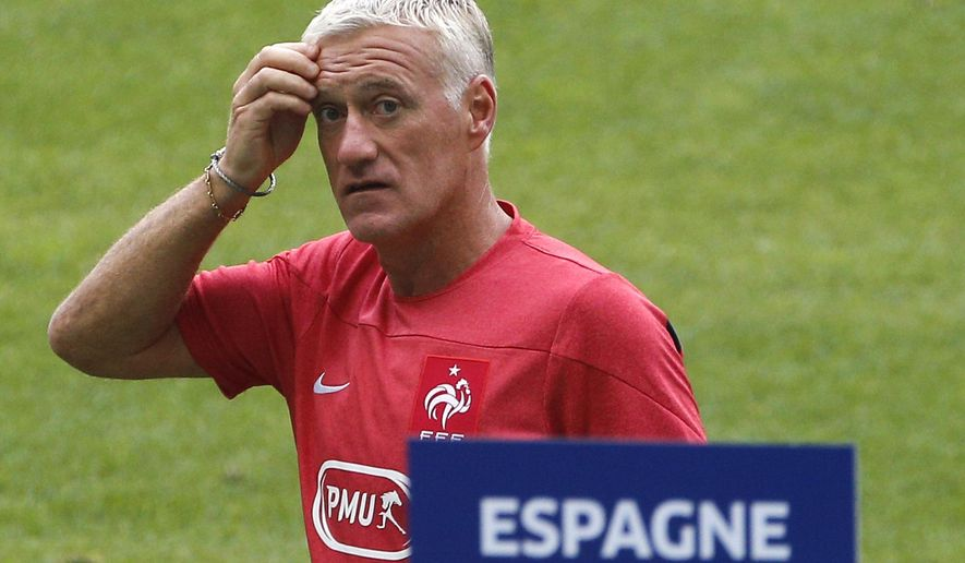 Head coach of the French national soccer team Didier Deschamps attends a training session at the Stade de France in Saint Denis, outside Paris, Wednesday, Sept. 3, 2014. France will play an international friendly soccer match against Spain in Saint Denis on Thursday, Sept. 4. (AP Photo/Christophe Ena)