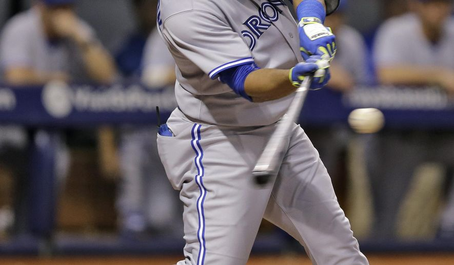 Toronto Blue Jays' Edwin Encarnacion connects for a two-run home run off Tampa Bay Rays starting pitcher Chris Archer during the fifth inning of a baseball game Wednesday, Sept. 3, 2014, in St. Petersburg, Fla. Blue Jays' Jose Bautista also scored on the play. (AP Photo/Chris O'Meara)