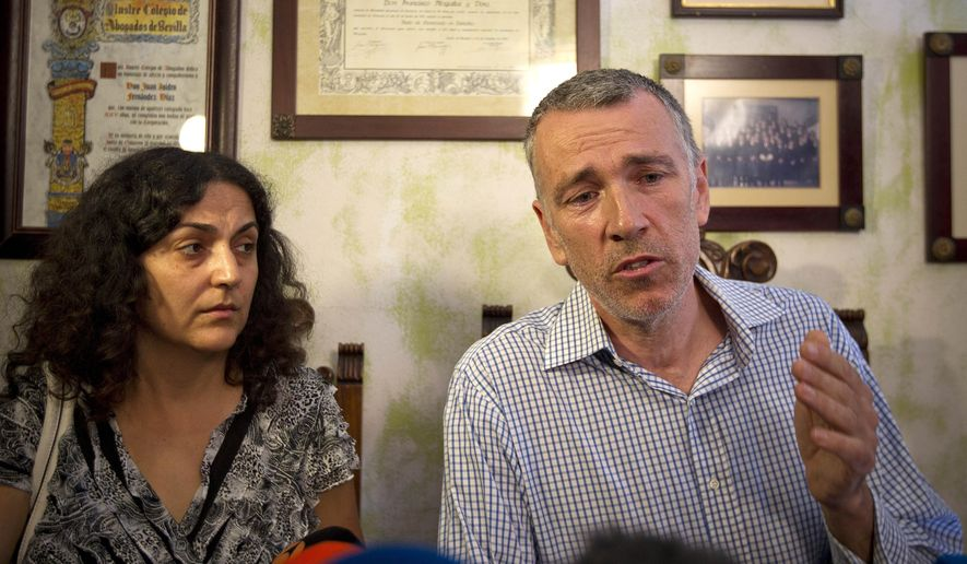Brett, right, and Naghemeh King, speaks during a press conference in Sevilla, Spain, Wednesday, Sept. 3, 2014. British prosecutors are dropping the case against a couple who ended up in a Spanish jail after they tried to get treatment abroad for their son's severe brain tumor, authorities said Tuesday. Brett and Naghemeh King were pursued by police after they took 5-year-old Ashya out of a hospital in southern England against doctors' advice and traveled to Spain, where they planned to sell a property to pay for proton beam radiation therapy in the Czech Republic or the U.S. They were arrested on a British warrant on suspicion of cruelty to a person under 16 years of age, and were in custody in a jail near Madrid. (AP Photo/Miguel Angel Morenatti)