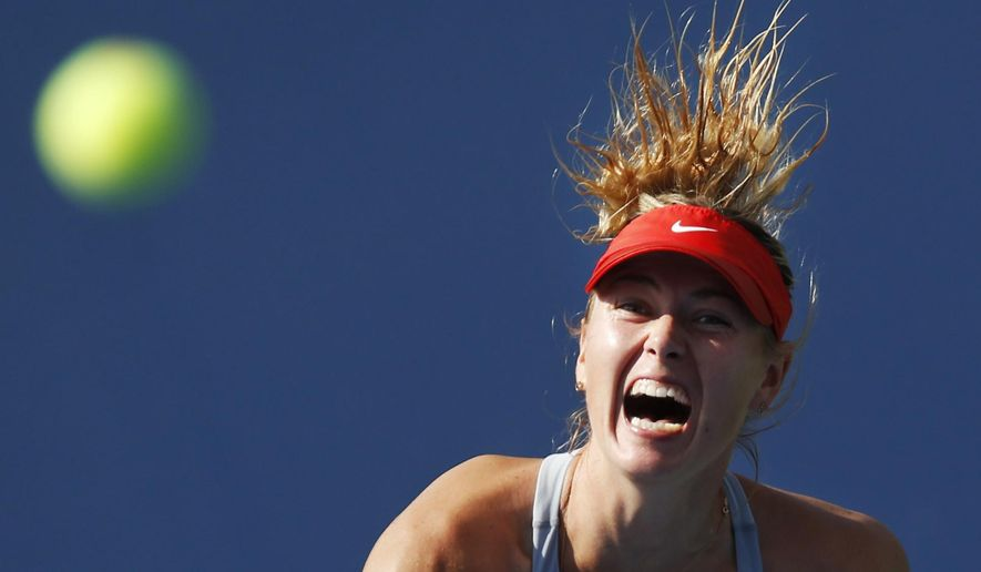 10ThingstoSeeSports - Maria Sharapova, of Russia, serves against Caroline Wozniacki, of Denmark, during the fourth round of the 2014 U.S. Open tennis tournament, Sunday, Aug. 31, 2014, in New York. (AP Photo/Kathy Willens, File)