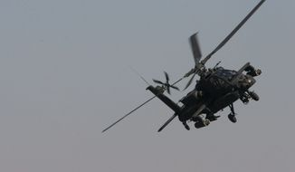 An AH-64 Apache attack helicopter. (Associated Press)