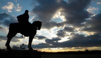 "A statue of Confederate Gen. Thomas ""Stonewall"" Jackson stands at Manassas National Battlefield Park at Manassas, Virginia. The park offers three hiking trails of varying lengths, a ranger-led walking tour and a network of roads that allows for self-guided driving tours. (Associated Press photographs)"