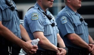 SMILE: Body-mounted cameras, like ones used by other U.S. police forces, are coming to District. (Associated Press)